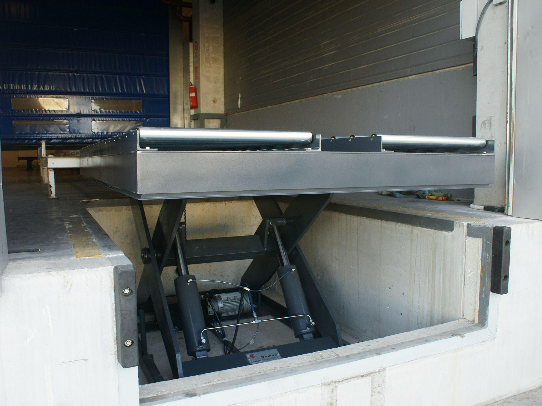 Mesas elevadoras para sistemas de carga
